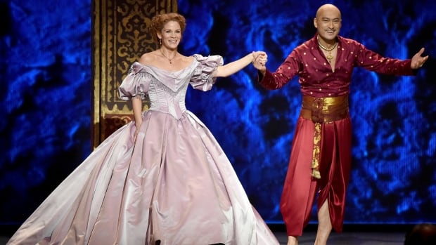 Ken Watanabe and Kelli O'Hara are seen at the end of a scene from the King and I during the 2015 Tony Awards.