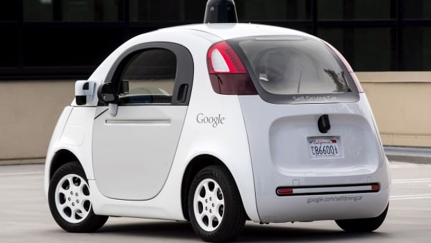 Journalists take a test drive in a prototype of Google's self-driving car in Mountain View, Calif., on Sept. 29, 2015.  A new ruling from the U.S. vehicle safety regulator may make it easier for the company to get its fleet of autonomous vehicles on the roads.