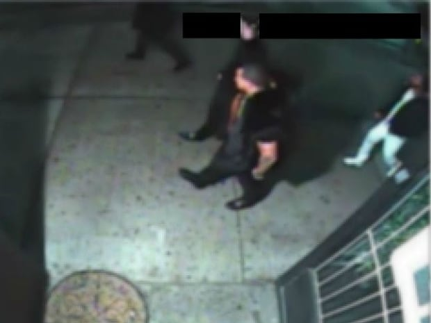 This is one of a handful of security camera images police released Wednesday in connection with a Jan. 31 shooting in Chinatown that killed two men in their 20s. Police did not say whether the people in the photos are suspects or potential witnesses.