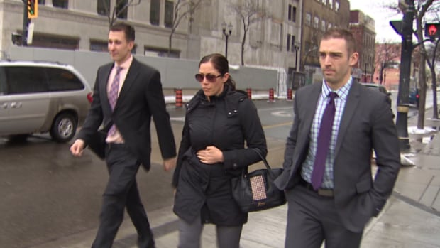 Det. Const. Lauren Troubridge (centre) and Const. Brent Gibson (right) leave the John Sopinka Courthouse in Hamilton on Wednesday. Troubridge testified that the trailer containing Bosma's truck opened up on the highway while being towed to a forensics facility.