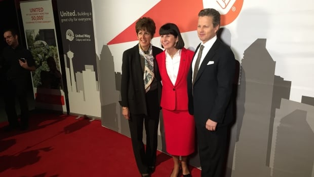 United Way CEO Lucy Miller (centre), smiles for a photo with the agency's 2016 fundraising campaign co-chairs Deborah Yedlin and Mick Dilger.