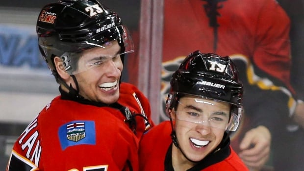 The Flames' Sean Monahan, left, and Johnny Gaudreau missed Tuesday's game against Toronto after showing up late to that day's practice.