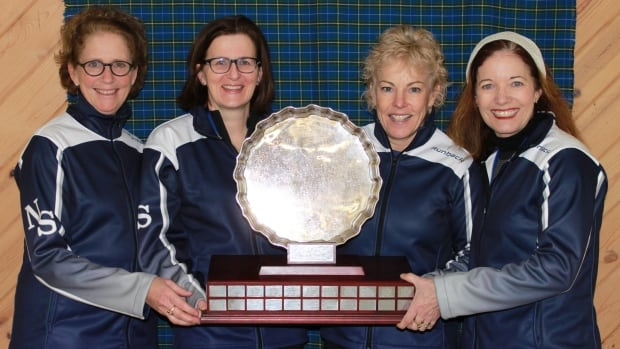 Nancy Delahunt, Mary Sue Radford, Kim Kelly and Colleen Jones curling