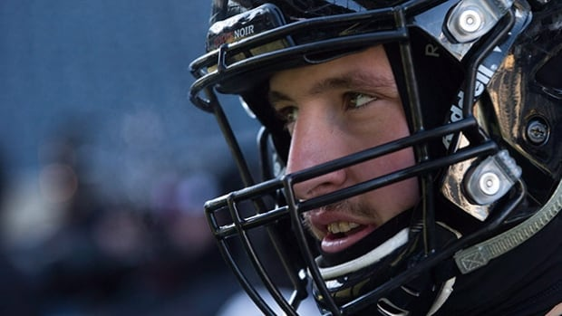 Ottawa Redblacks' Justin Capicciotti is interviewed after Grey Cup football practice in Winnipeg, Man., on Friday November 27, 2015. THE CANADIAN PRESS/Darryl Dyck