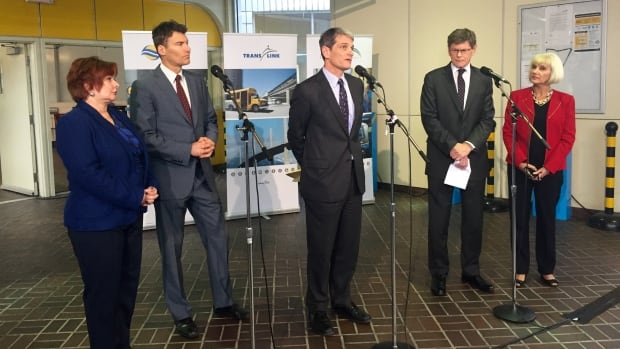 Kevin Desmond, centre, will assume the role of TransLink CEO March 21.