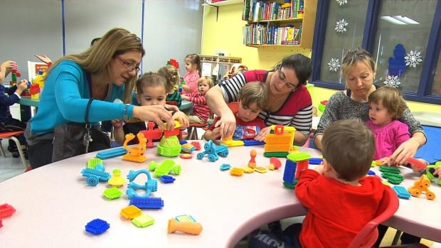Many parents, like these mothers playing with their children at a daycare, are unprepared for the tax bill they'll get to cover the increase in fees that went into effect in April 2015.
