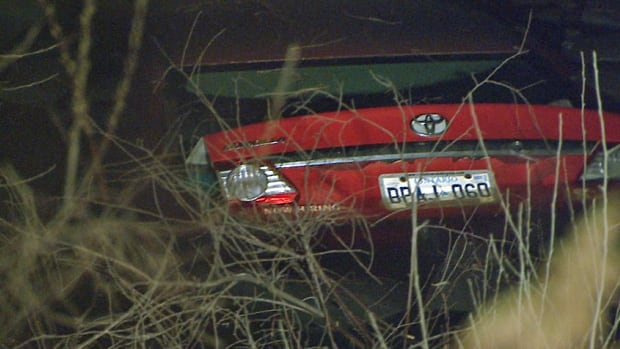 A woman managed to escape from this car after crashing into an icy pond early Thursday.
