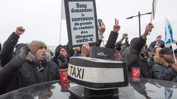 Cabbies held an anti-Uber demonstration at Pierre Elliott Trudeau Airport in Montreal on Feb. 10, 2016, causing a major traffic snarl.