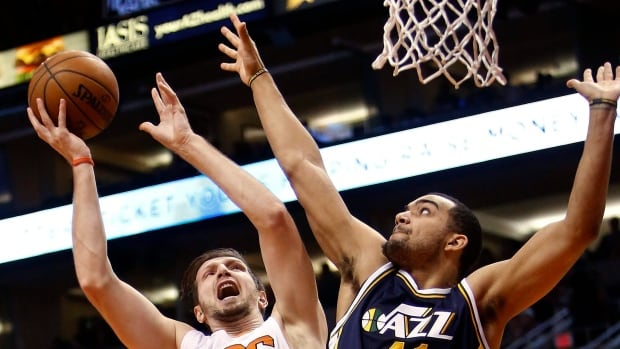 Phoenix Suns forward Mirza Teletovic (35) drives on Utah Jazz forward Trey Lyles during the fourth quarter of an NBA basketball game Saturday, Feb. 6, 2016, in Phoenix. The Jazz defeated the Suns 98-89.