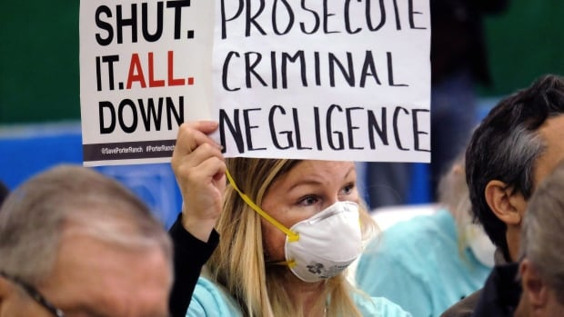Tera Lecuona, a resident of the heavily-impacted Porter Ranch area of Los Angeles, holds a protest sign in January during a hearing in Granada Hiulls over a gas leak at Southern California Gas Company's Aliso Canyon Storage Facility. The utility says they have 'have temporarily controlled the natural gas flow' from the well.