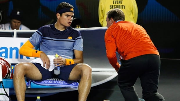 Milos Raonic talks to a trainer during his semifinal match against Andy Murray at the Australian Open tennis championships in Melbourne, Australia on Jan. 29.