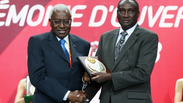 Athletics Kenya president Isaiah Kiplagat, right, shown with former IAAF president Lamine Diack, is under a 180-day suspension for potential subversion of the Kenyan anti-doping process. Now Kenya is also facing a WADA investigation as well.