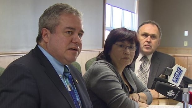 Whitehorse mayor Dan Curtis, flanked by Kwanlin Dun First Nation Chief Doris Bill and Yukon Premier Dennis Pasloski, speaks to reporters about the a new plan to tackle homelessness in the Yukon capital.