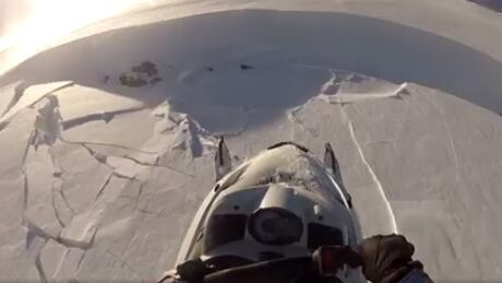 Snowmobiler survives avalanche, captures it on camera
