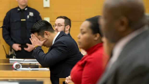 Police officer Peter Liang reacts as the verdict is read during his trial on charges in the shooting death of Akai Gurley on Thursday at Brooklyn Supreme court in New York.