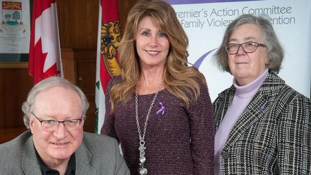 P.E.I. Premier Wade MacLauchlan, Family and Human Services Minister Tina Mundy and Ann Sherman, chair of the Premier's Action Committee on Family Violence Prevention.