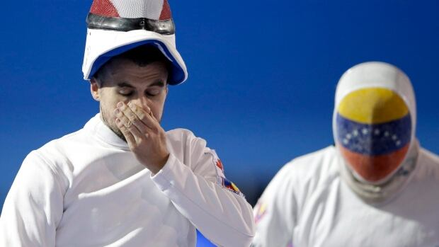 Canadian fencer Maxime Brinck-Croteau, left, won't even let himself think about how it would feel to qualify for the 2016 Rio Olympics.