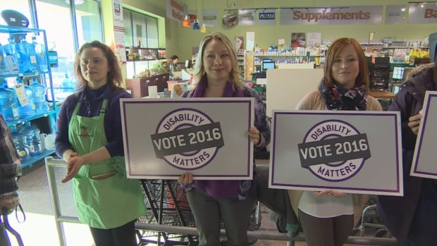 People gathered at The Fresh Carrot grocery store near Confusion Corner to support the Disability Matters: Vote 2016 announcement.