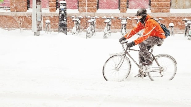 Feb. 12 is Bike to Work Day in Calgary. Frostbike author and bike blogger Tom Babin shares four tips for winter cycling safety.