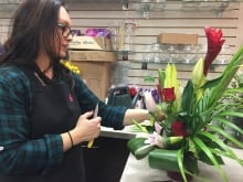 Bunches employee Amanda Dhillon readies one of several bouquets at the store.