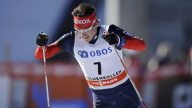 Maxim Vylegzhanin of Russia won the men's 10-kilometre World Cup cross-country race, helping the Russians finish in the top two positions.