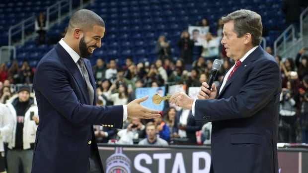 Rapper Drake receives a key to the city from Toronto mayor John Tory at the NBA All-Star Celebrity Game Friday.