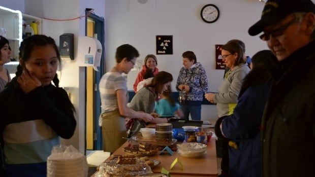 Residents of Uluhaktok persue the goods at Helen Kalvak Elihakvik School.