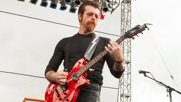 Jesse Hughes of Eagles of Death Metal, seen here performing at a 2015 music festival, will return to Paris on tour with the band.