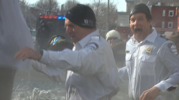 Police officers take part in the annual Polar Bear Plunge fundraiser for the Special Olympics.