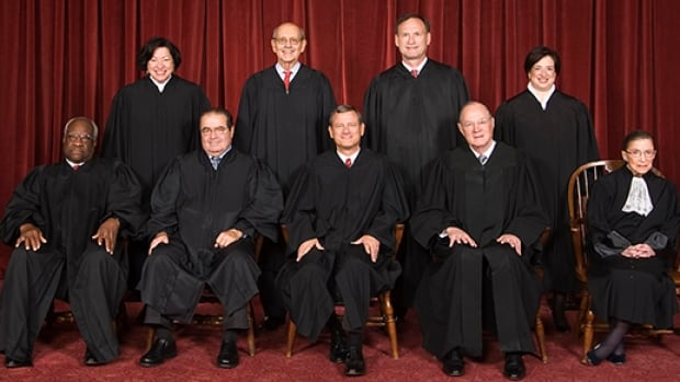 The U.S. Supreme Court: seated left to right: Justice Clarence Thomas, Justice Antonin Scalia, Chief Justice John G. Roberts, Justice Anthony M. Kennedy, Justice Ruth Bader Ginsburg. Standing left to right: Justice Sonia Sotomayor, Justice Stephen G. Breyer, Justice Samuel A. Alito, Jr., Justice Elena Kagan.