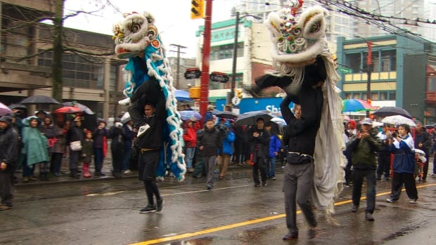 Dancers jumped on top of each other to simulate the movements of a lively dragon during Vancouver's Lunar New Year parade.