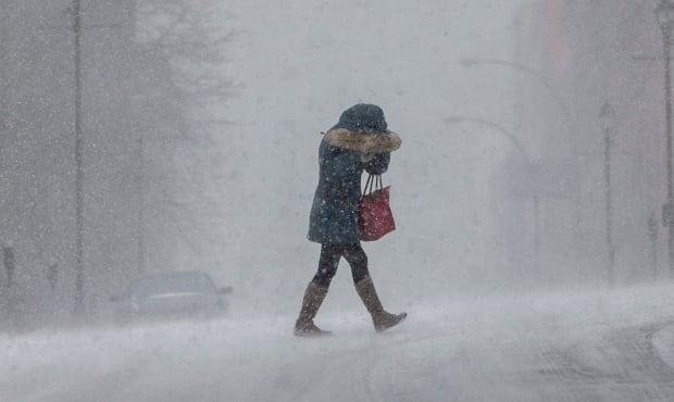 Winter Storm generic woman walking snow