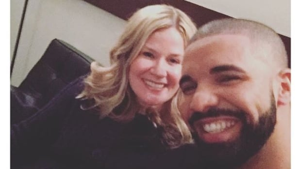 Drake took in the NBA All-Star game with high school teacher Kim Janzen.