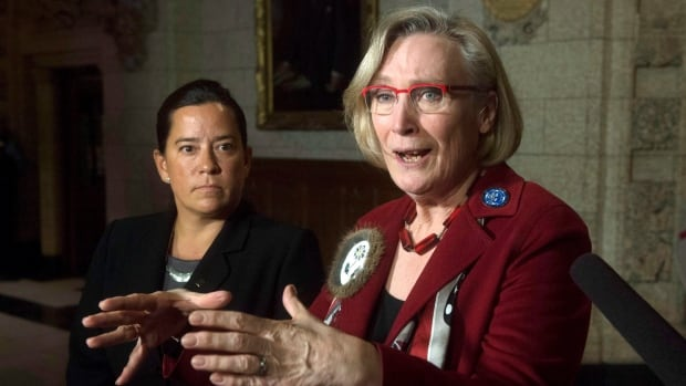 Minister of Justice and Attorney General of Canada Jody Wilson-Raybould, left, looks on as Minister of Indigenous and Northern Affairs Carolyn Bennett speaks.