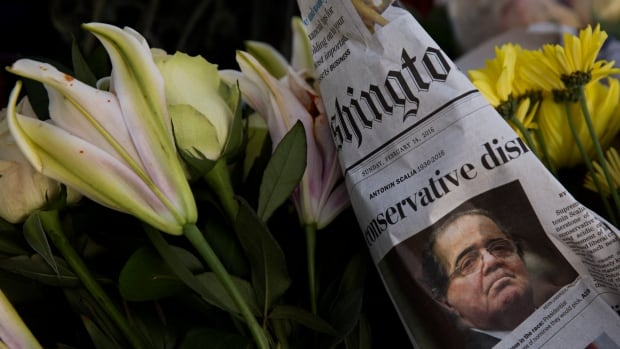 A makeshift memorial for Antonin Scalia is seen at the U.S. Supreme Court in Washington, D.C., one day after the justice's death at the age of 79.