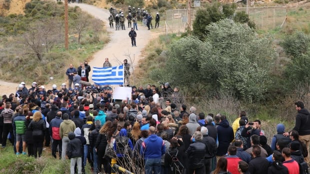 Anti-hot spot protesters in Pyli marched as close as they could Sunday to an old military camp earmarked to be one of Greece's five migrant-processing centres. They were stopped by riot police who fired tear gas on the crowd.