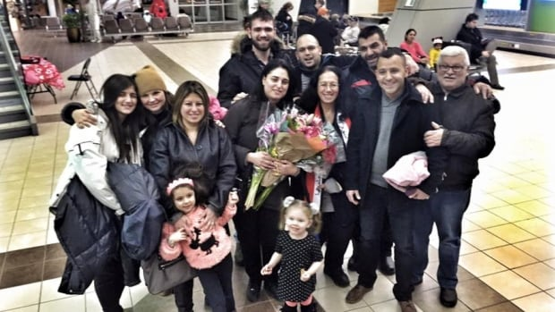 Sally Mitri reunited with her family members from Syria at the Regina International Airport.