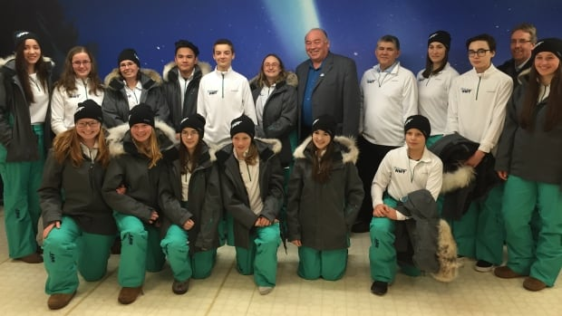 N.W.T. Premier Bob McLeod with a group of Team N.W.T. athletes modelling this year's Arctic Winter Games uniform.