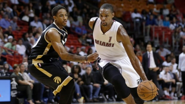 Miami Heat forward Chris Bosh (1) pulled out of the All-Star Game and the 3-point contest because of what he and the Heat described as a calf strain.