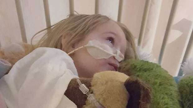 Katie Smith, 2, is recovering at Sick Kids Hospital after surgery to remove a battery she swallowed. Her parents took her to five different doctors before the problem was diagnosed.
