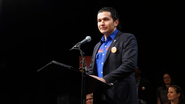 Wab Kinew speaks at an NDP event in Winnipeg on Tuesday. Kinew has been officially nominated as the party's candidate in Fort Rouge.