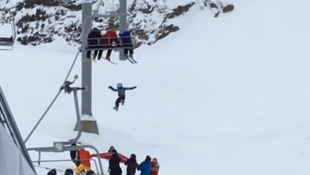 A child falls to a safety net from the Peak Express chairlift at the Whistler-Blackcomb ski resort.