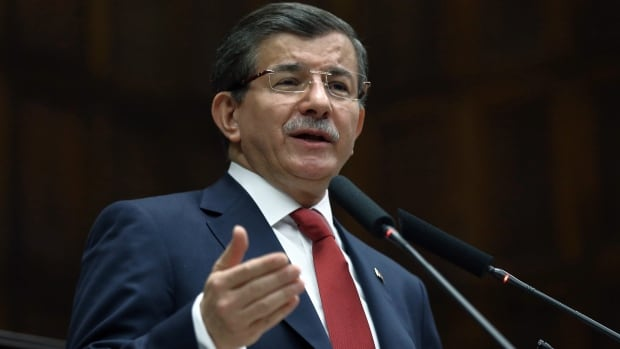 Turkish Prime Minister Ahmet Davutoglu addresses his lawmakers in Ankara  on Tuesday.