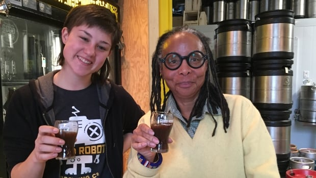 "Jillian Moran (left) of Good Robot Brewing Company and Halifax journalist Evelyn White sample ""Ale to the Chief"" at the brewery in Halifax's north end."