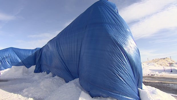 The snow structures and sledding hills at the Charlottetown Events Grounds were covered with tarps to help protect them from the warm weather.