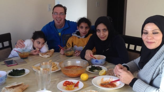 Andre Dorais of Yellowknife and four members of the Syrian refugee family he and his wife met while staying at an Edmonton hotel. The family had the Canadian couple over for lunch, serving up a Syrian take on traditional western fare — spaghetti, french fries and spinach.