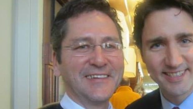 Daniel Pottle, seen here in a Facebook photo with Prime Minister Justin Trudeau, has been dismissed as a Nunatsiavut minister.