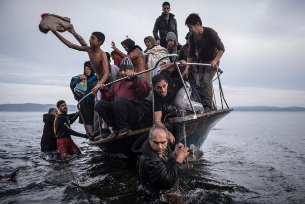 World Press Photo 2016 General News 1st prize stories winner migrant crisis by Sergey Ponomarev
