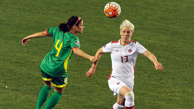Canada's Sophie Schmidt, right, and Guyana's Kayla De Souza chase after the ball during the first half of a CONCACAF Olympic qualifying match on Feb. 11 in Houston, Texas.