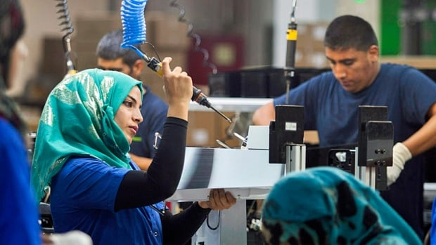 Employees work at the new SodaStream factory built deep in Israel's Negev Desert next to the city of Rahat, Israel, that replaced the West Bank facility.